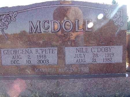 MCDOLE, NILE C.